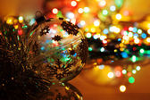 Colorful silhouette of christmas ball on new year's bokeh backgr — Stock Photo