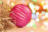 Colorful christmas ball on new year's lights bokeh background — Stock Photo