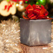 Stock Photo: Silver gift box with red ribbon on Christmas festive background