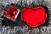 Valentine gift box with heart shape toy on wooden background wit — Stock Photo