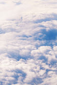 Amazing cloudy sky view from airplane window — Stock Photo