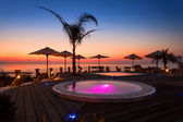 Amazin sunset view from hotel spa area with creative pools — Stock Photo