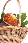 Bunch of figs in a basket isolated on white background — Stock Photo
