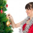 Woman decorating christmas tree — Stock Photo #12274306