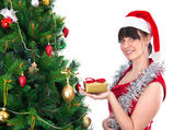 Woman near christmas tree — Stock Photo