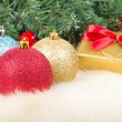 Christmas balls and gift — Stock Photo