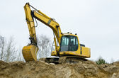 Yellow excavator on sandpit — Foto Stock