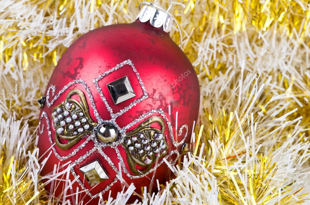 Red christmas ball in yellow christmas decoration.  Stock Photo #12393757