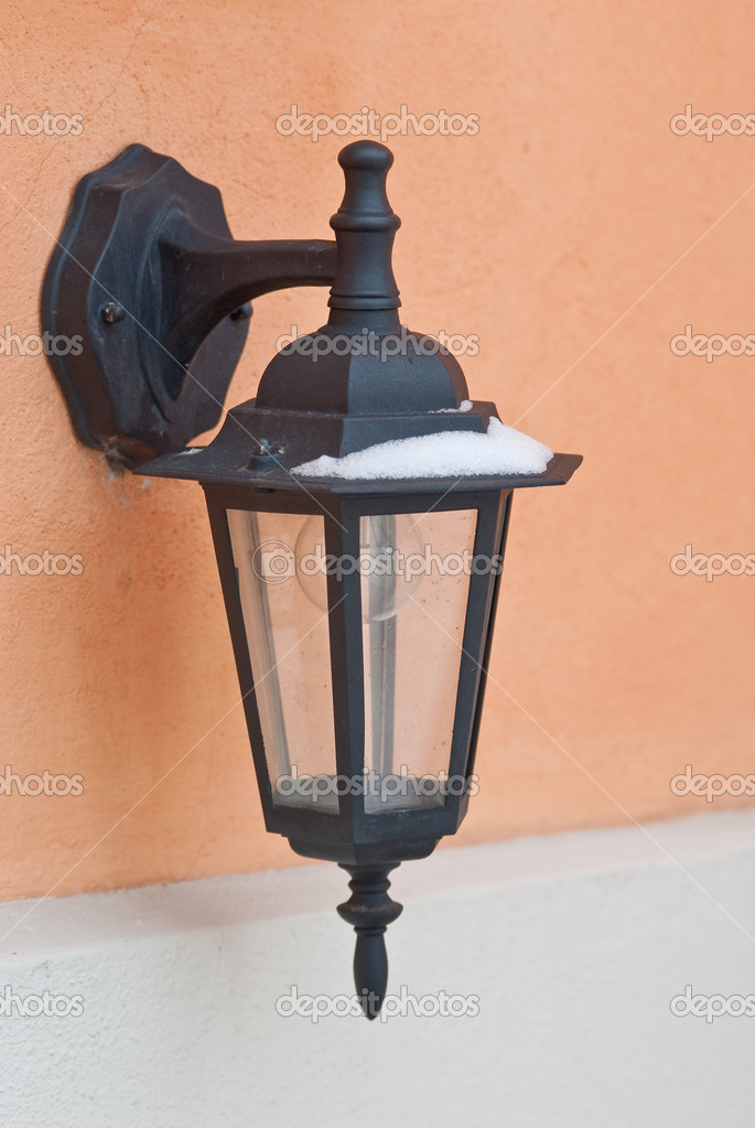 Old-fashion street lighting on the wall — Stock Photo #13368080