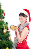 Young woman with christmas gift — Stock Photo