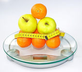 Fruits on scales — Stock Photo