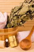 Bucket with sauna accessories — Stock Photo