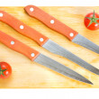 Kitchen knives on chopping board — Stock Photo