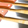 Kitchen knives in a row — Stock Photo