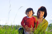 Young woman with daughter — Stock Photo