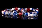 Handmade beads over black — Stock Photo