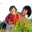 Little girl with young woman — Stock Photo #27054025
