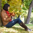 Stock Photo: Woman sitting under the tree