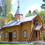 Small wooden orthodox church — Stock Photo #34859989