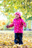 Little girl playing outdoors — Stock Photo