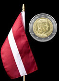 National flag of Latvia and euro coin — Stock Photo
