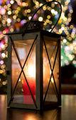 Christmas lantern and christmas lights — Stock Photo
