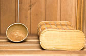 Old rusty sauna ladle — Stock Photo