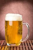 Golden light beer in mug — Stok fotoğraf