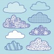Blue background with raining clouds — Stock Vector