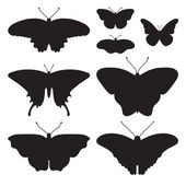 Black silhouettes of butterflies — Stock Vector