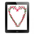Heart of frame in tablet — Stock Photo