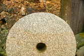 Detail of a millstone, of stone — Stockfoto