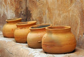 Clay pots on the shelf — Stock Photo