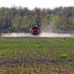 Farmer sprays the fields — Stock Photo #25083273