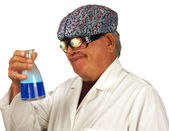 Mad scientist brews a concoction — Stock Photo