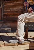 Cowboy steps onto the porch — Stock Photo