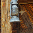 Old lantern hangs on the post — Stockfoto