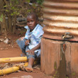 Boy sitting near the water tank — Stock Photo