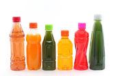 Bottles of Fruit Juices on White Background — Stock Photo