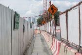 Walkway with safety fenced in construction zone — Stock Photo