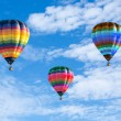 Colorful hot air balloons on the blue sky — Stock Photo