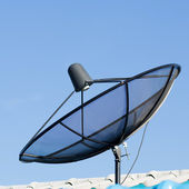 Satellite Dish against blue sky — Stock Photo