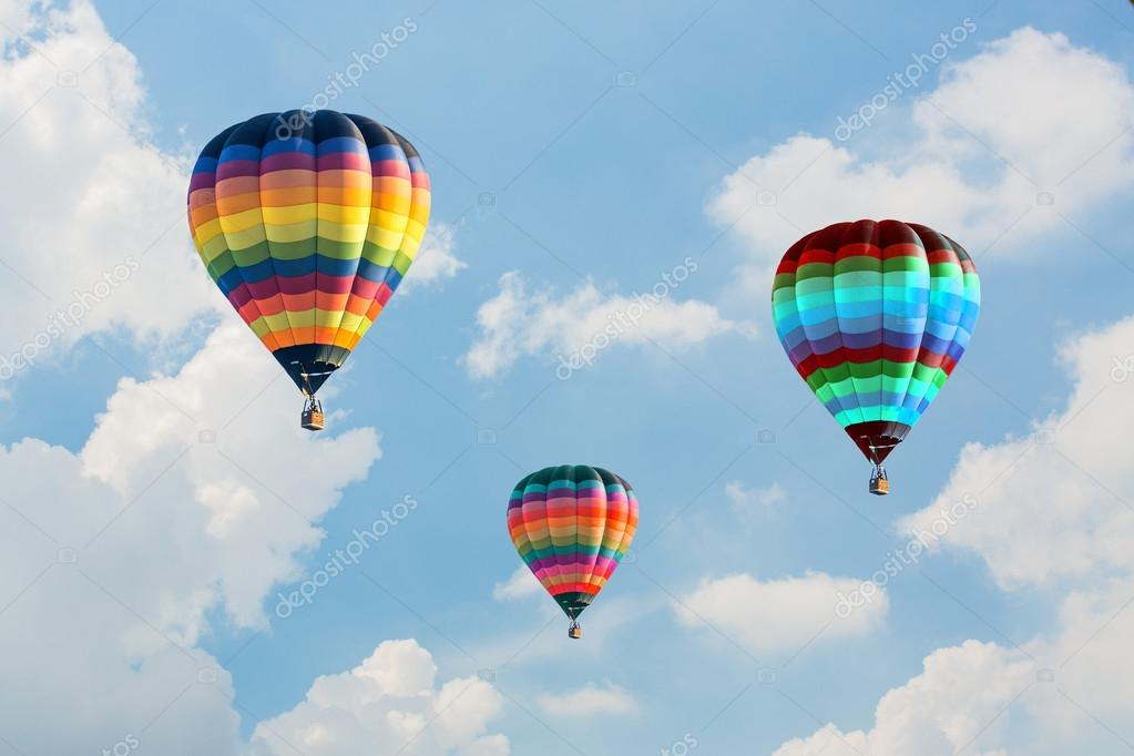 Colorful hot air balloons on the blue sky — Stock Photo ...