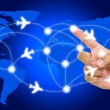 Hand point on airline route with world map background — Stock Photo