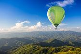Colorful hot air balloon over the mountain — Stock Photo