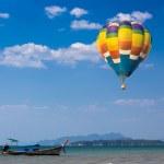 Hot air balloon over the sea — Stock Photo #41731389