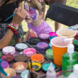 Young girl getting her face painted as a butterfly — Stock Photo #12383037