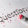 Stock Photo: Erasing Questions