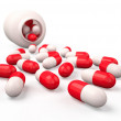 Pills spilling out of pill bottle isolated on white. — Stock Photo #27252563