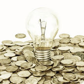 Lamp on coins — Stock Photo